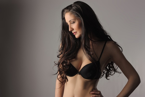 Woman in bra after breast augmentation